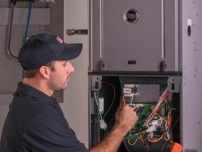 Technician repairing A/C unit